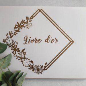 livre d'or blanc et dore pour mariage avec couronne de fleurs doree par idealisa