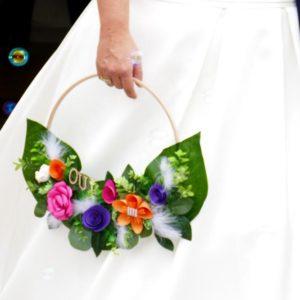 bouquet de mariee couronne aux couleurs pep's avec des roses et des fleurs en papier etoile fushia violet et orange